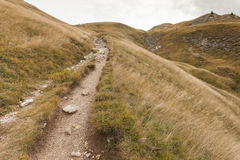 Walking long a mountain path in Valle di Funes into the Italian Dolomites Royalty Free Stock Image