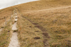 Walking long a mountain path in Valle di Funes into the Italian Stock Image