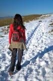 Walking on long snow path Stock Photos