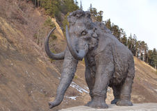 Walking mammoth against precipice Stock Photography