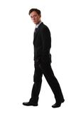 Walking man. Man walking over a white background, isolated Stock Image
