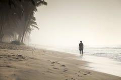 Walking man on a beautiful tropical beach Stock Image