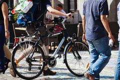 Walking man with a bicycle in the city Stock Image