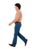 Walking man. Casual man walking on white background Royalty Free Stock Images
