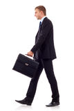 Walking man holding brief Stock Photo
