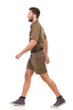 Walking man in khaki uniform Royalty Free Stock Images