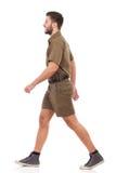 Walking man in khaki uniform Royalty Free Stock Images
