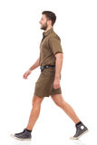 Walking man in khaki uniform Stock Photo