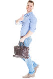 Walking man with laptop bag Royalty Free Stock Photos