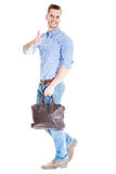 Walking man with laptop bag Stock Photography