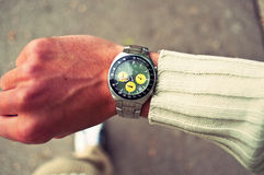 Walking man looking at his watch. Royalty Free Stock Photography