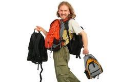 Walking Man with many backpacks Royalty Free Stock Image