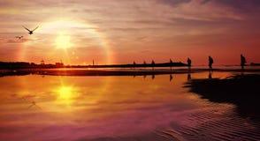 Walking Man. Miutiple shots of man walking along venician peninsular beach towards the sunrise royalty free stock image