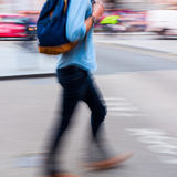 Walking man in motion blur. Walking man in the city in motion blur Royalty Free Stock Photography