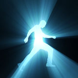 Walking man spot light ray flare Royalty Free Stock Photos