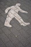 Walking man spraypainted on a road Royalty Free Stock Photo
