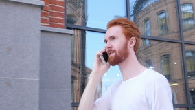 Walking Man Talking on Phone, Loft Building Background stock footage