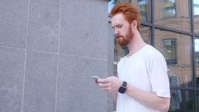 Walking Man Typing Text on Smartphone, Side view. Creative designer , businessman stock video