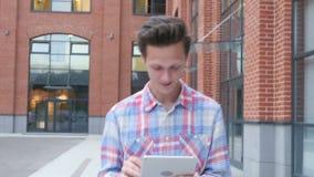 Walking Man Using Tablet. Creative designer , businessman stock video