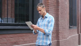 Walking Man Using Tablet, Going to Office, Slow Motion stock video footage