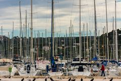 Walking in the marina with sail boats stock photos