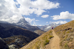 Walking at Matterhorn trail. About 400 kilometres of marked hiking paths and mountain trails around Zermatt, Täsch and Randa offer varying degrees of difficulty Stock Image
