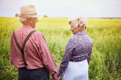 Walking through meadow Stock Photo