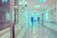 Walking medical workers in the hospital on the background of dri Stock Image