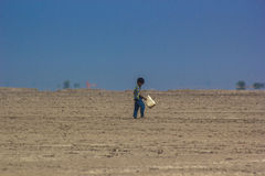 Walking Miles: Water Scarcity Stock Image