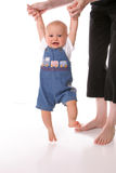 Walking with mommy overalls Royalty Free Stock Photo