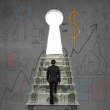 Walking on money stairs to key door with business dooles Royalty Free Stock Image