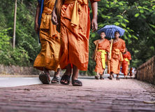 Walking monks Royalty Free Stock Images