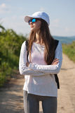 Walking is the most natural exercise. Walking is the most natural exercise, brunette beauty hiking Stock Photos