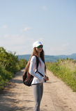 Walking is the most natural exercise. Walking is the most natural exercise, brunette beauty hiking Stock Images