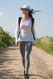 Walking is the most natural exercise. Walking is the most natural exercise, brunette beauty hiking Stock Photo