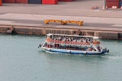 Walking motor ship in seaport water area. Barcelona, Spain Stock Image