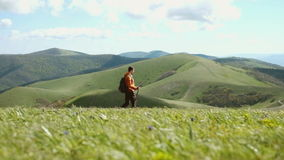 Walking into the mountains. stock footage