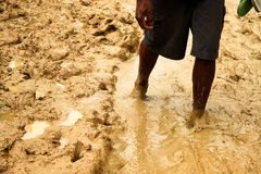 Walking in mud Royalty Free Stock Photography