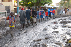 Walking in Mud. September 26, 2008 - Locals in Gonaives, Haiti, wade through the mud deposited in the city by Hurricane Ike and Tropical Storm Hanna Stock Image