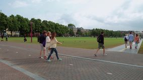 Walking at museum Square in Amsterdam - a great place to relax - AMSTERDAM - THE NETHERLANDS - JULY 19, 2017. Walking at museum Square in Amsterdam - a great stock video footage