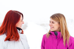 Walking with my good friend. Picture of two beautiful ladies talking a walk on wintertime Royalty Free Stock Photos