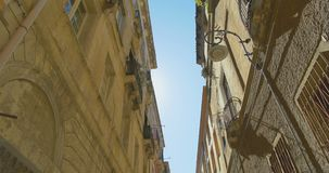 Walking in the narrow old european city. Old building tops view. Italy. Walking in the narrow old european city. Old building tops view stock video