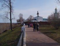 Walking near the church. Walking along the pedestrian path near the church in early spring Stock Photos