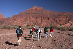 Walking near Tupiza. A group of people is trekking in the red mountains around Tupiza, in south Bolivia Stock Photo