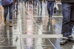Walking in New York City after the rain. With reflections on the concrete Royalty Free Stock Image