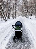 Winter walk. Baby stroller. royalty free stock photos