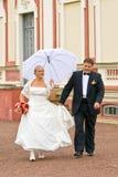 Walking newlyweds Royalty Free Stock Image
