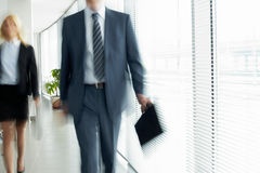 Walking in office Stock Images