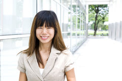 Walking by office building. Businesswoman walking by an office building Stock Photo