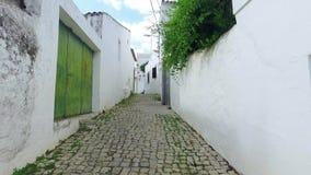 Walking on Old Narrow Street stock video footage